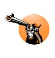 Bandit cowboy pointing a revolver hand gun vector