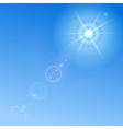 Blue sky with sun and lens flare vector