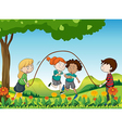 Four kids playing under the tree vector