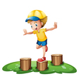 A smiling boy playing with the stumps vector