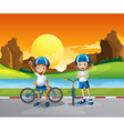 Two kids with their bikes standing at the road vector