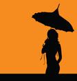 Girl silhouette with umbrella vector