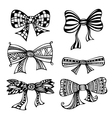 Set of ornate bows vector