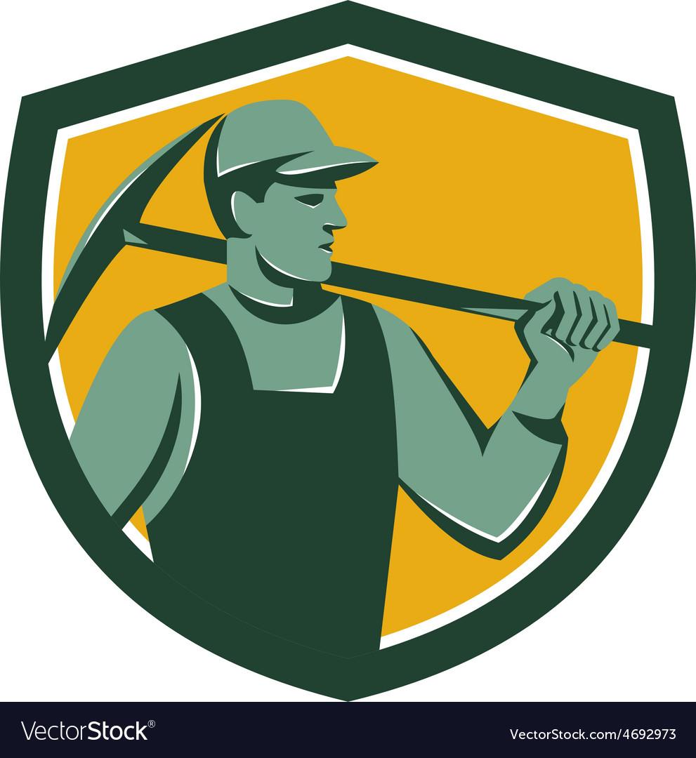 Coal miner with pick axe shield retro vector   Price: 1 Credit (USD $1)