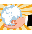 Bussines hand holding globe vector