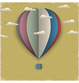 Retro hot air balloon and clouds from paper vector