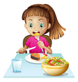 A little girl eating lunch vector