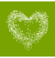White floral frame heart shape on green vector