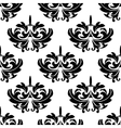 Damask style arabesque pattern with a floral motif vector