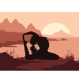 Silhouette of woman doing yoga in mountains vector