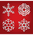 Christmas origami snowflakes on red background vector
