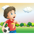 A boy holding a soccer ball wearing a red shirt vector