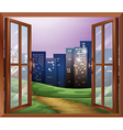 A window with a view of the tall buildings vector