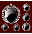 Set of silver emblem with shield and wreaths vector