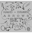 Hand-drawn arrows set vector