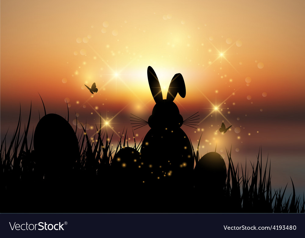 Easter bunny sat in grass against a sunset sky vector | Price: 1 Credit (USD $1)