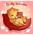 Cute ginger kitten on a red cushion vector
