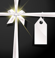 White gift bow with label on black background vector