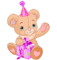 Teddy bear holding gift vector