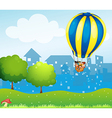 A big hot air balloon above the hill vector