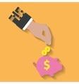 Business hand saving money in piggy bank vector