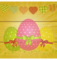 Easter eggs and bunting on wooden background vector