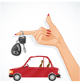 Woman hand with auto key and red car on the back vector