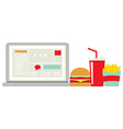 Fast food beside laptop for worker vector