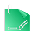Green sticker with curled corner and paper clips vector