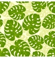 Seamless tropical pattern with stylized monstera vector