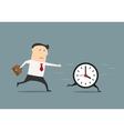 Businessman chasing a running clock vector