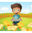 A boy in the garden holding an empty egg tray vector