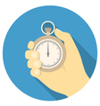 Stopwatch in hand vector