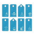 Set of blue tags with white christmas motifs vector