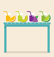 Set of fruit juice glasses on wooden table vector