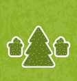 Green paper cut-out christmas tree fnd gifts vector