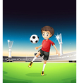 A boy playing soccer alone vector
