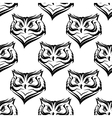 Seamless pattern of the head of a fierce owl vector
