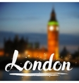 White calligraphy london sign on blurred photo vector