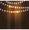 Christmas lights on wooden background vector