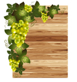 White grapes on a wooden background vector
