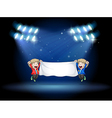 Two boys holding a banner under the spotlights vector