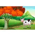 A smiling cow near the big tree vector