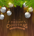 Christmas balls on wooden background vector