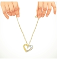 Male hands holding a gold chain with pendant-heart vector
