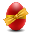 Red easter egg with yellow bow vector