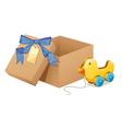 A wooden duck beside a brown box vector