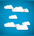 Clouds cut from paper on blue sky background vector