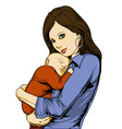 Young woman holding baby vector