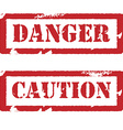 Rubber stamp with text danger and caution vector
